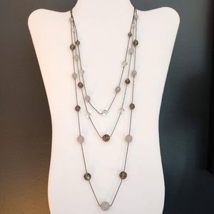 Layered gray and clear glass bead necklace